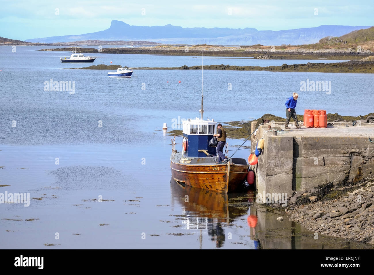 Arisaig, Scotland: A small supply boat prepares to leave Arisaig for the Isle of Muck - Stock Image