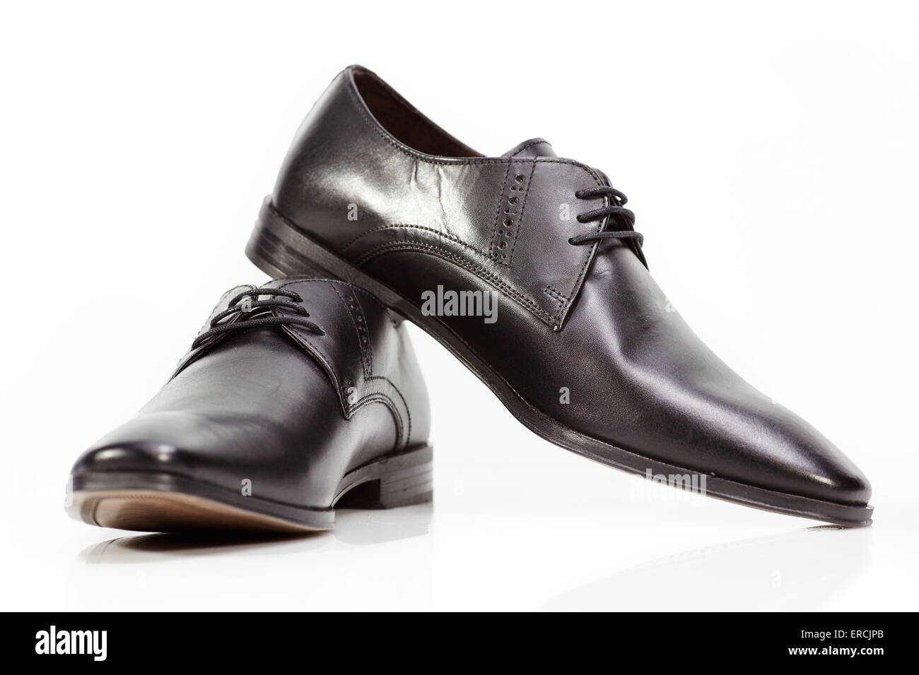 Male mans mens black leather shoes formal white background - Stock Image