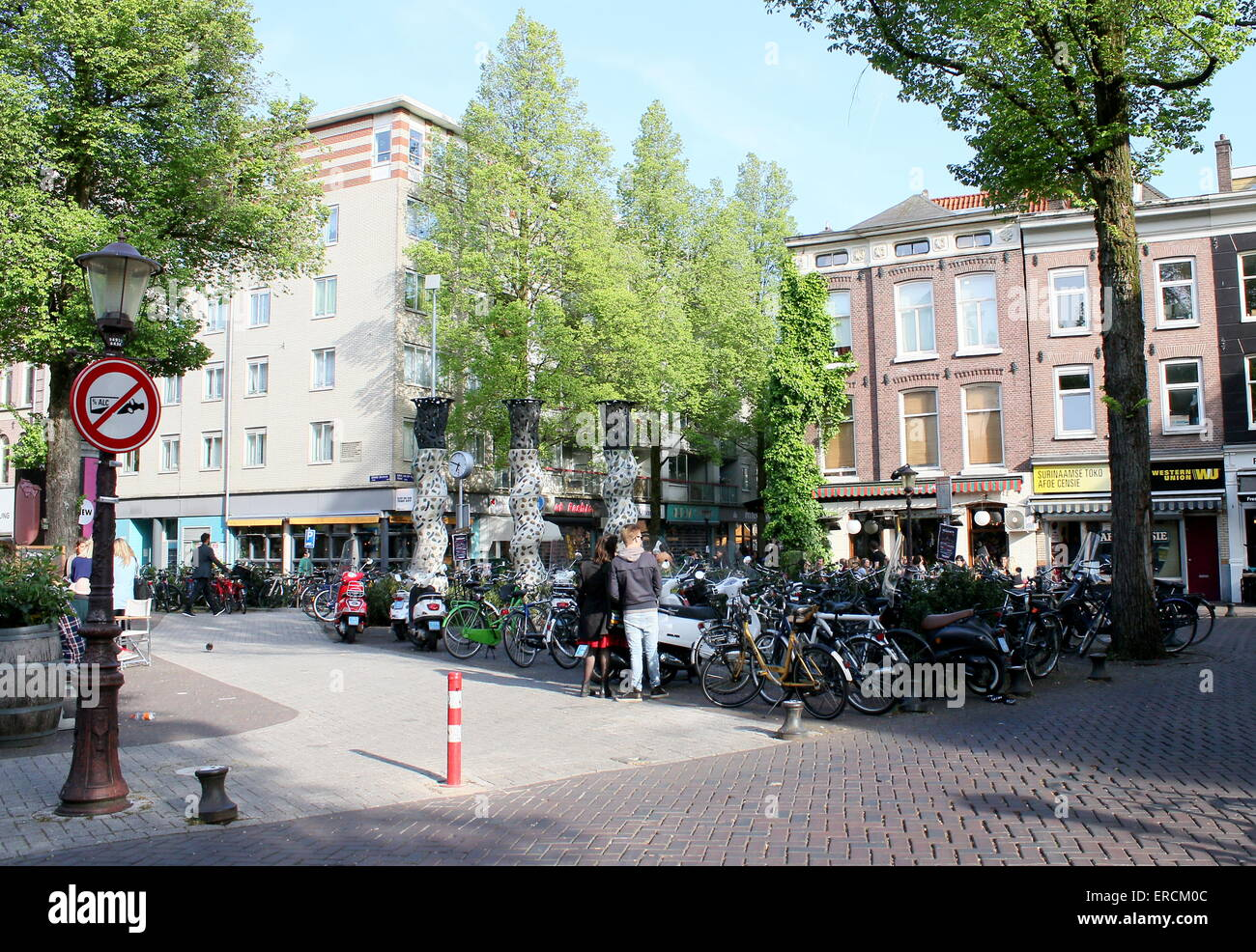 People  wining and dining on a summer evening at Gerard Douplein, de Pijp district, Amsterdam - Stock Image