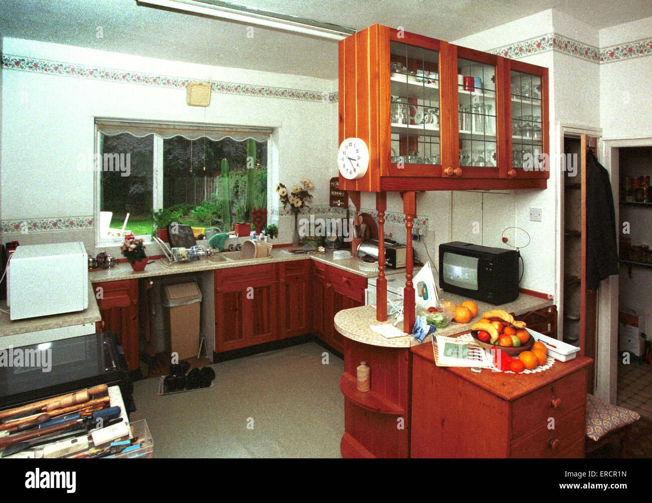 home improvements, old fashioned kitchen with pine cabinets in need of modernisation Stock Photo