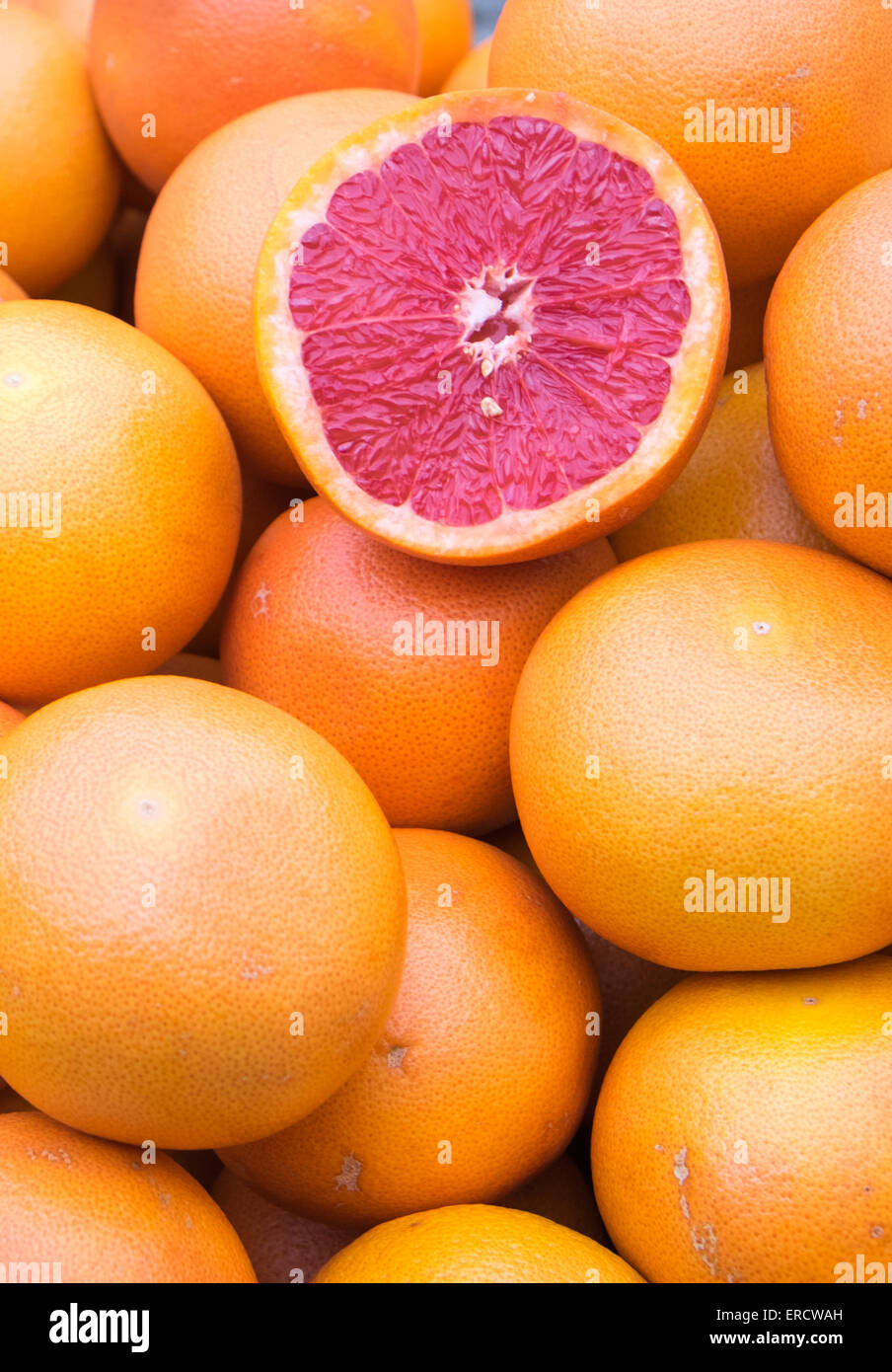 Ripe blood oranges for sale at a market - Stock Image