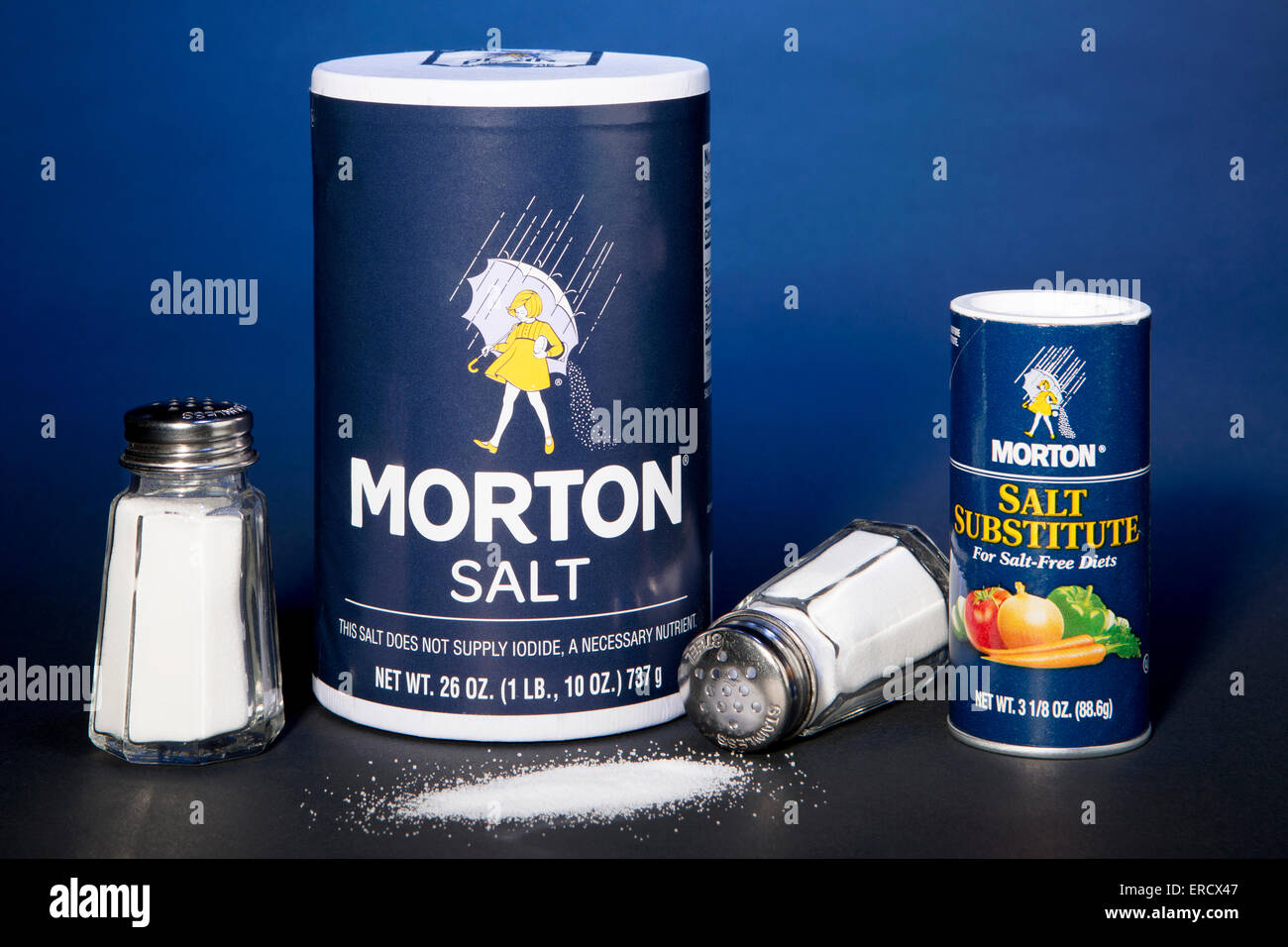 Morton Salt container next to a container of Morton Salt Substitute (made with Potassium chloride) - Stock Image
