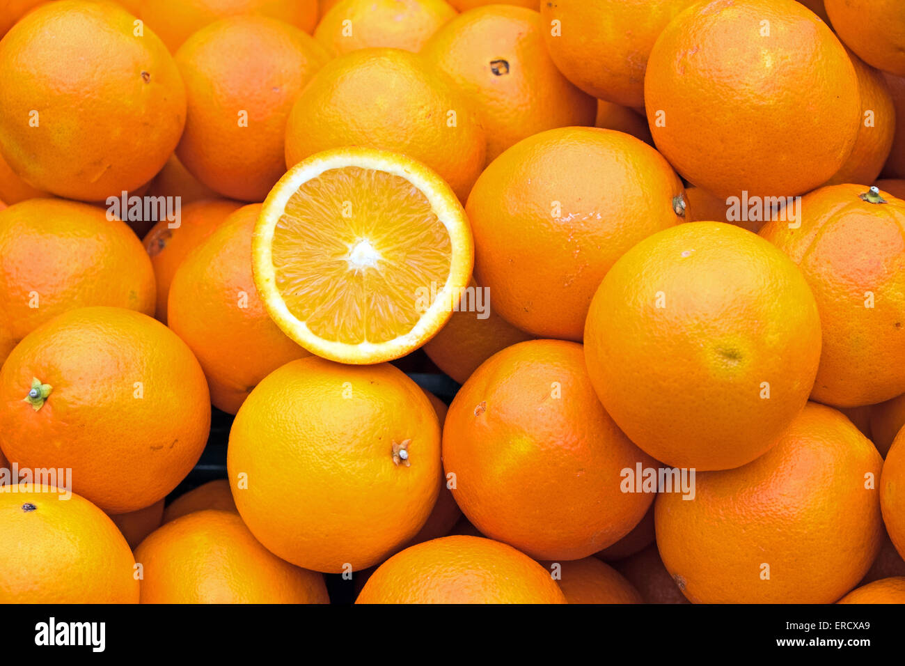 Ripe oranges for sale on a market - Stock Image