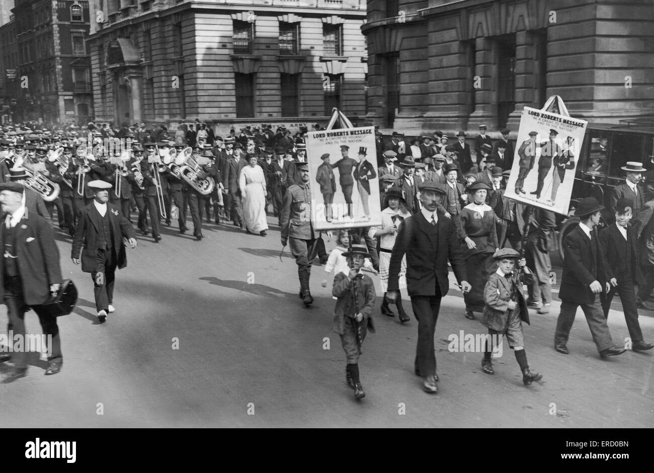 Two small boys carrying banners with the message from Lord Roberts 'Be a credit to yourself and the nation' - Stock Image