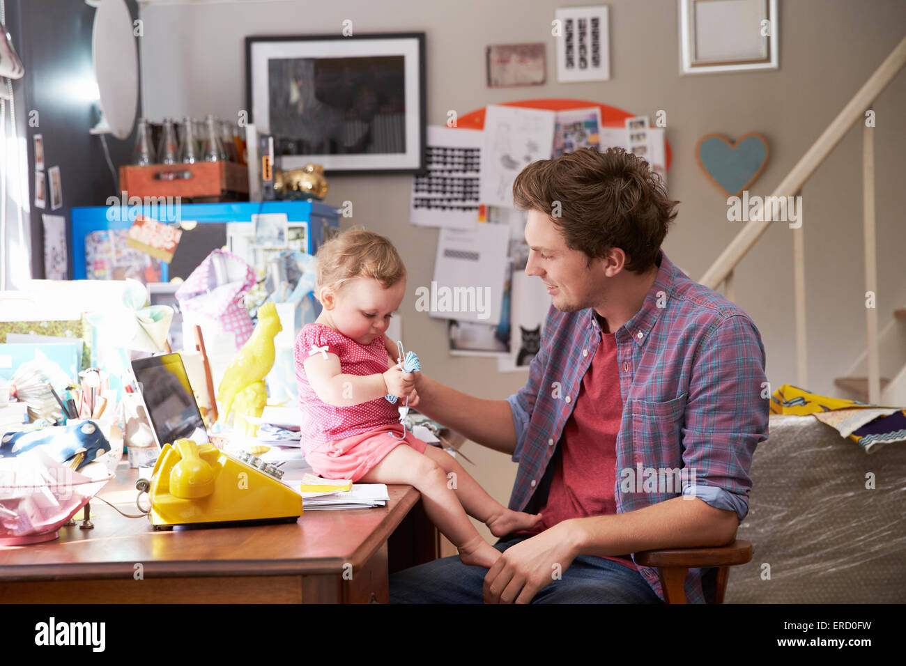 running home office. Father With Daughter Running Small Business From Home Office E