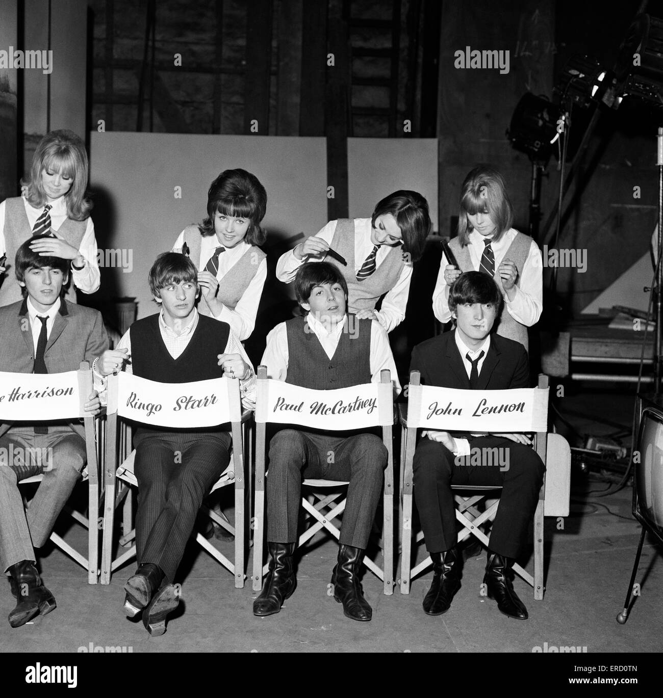 The Beatles being groomed at Twickenham Film Studios by Pattie Boyd and three A Hard Day's night extras, Tina - Stock Image