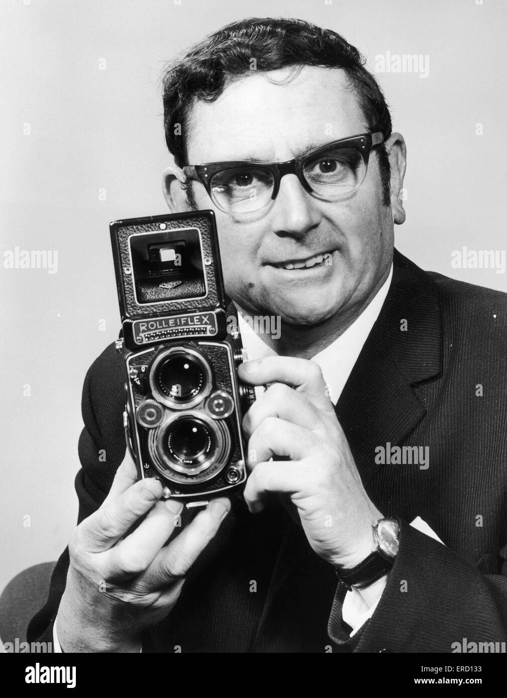 Charles Ley Daily Mirror Staff Photographer seen here with his trusty Rolleiflex camera. 22nd January 1970 - Stock Image
