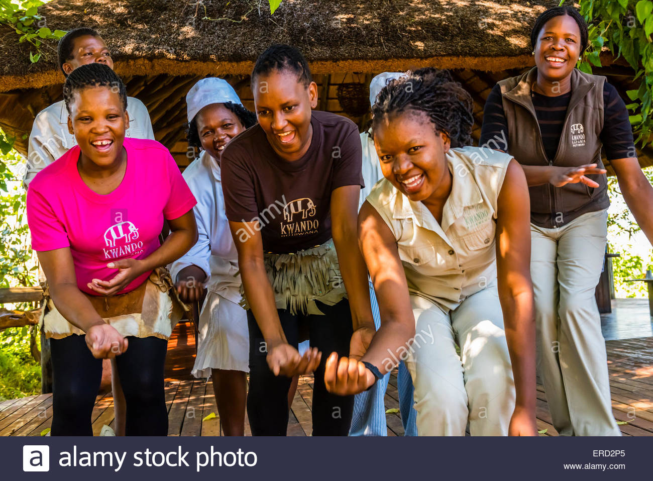 Staff members of the Lebala Safari Camp at the Kwando Concession do a traditional singing and dancing performance, - Stock Image