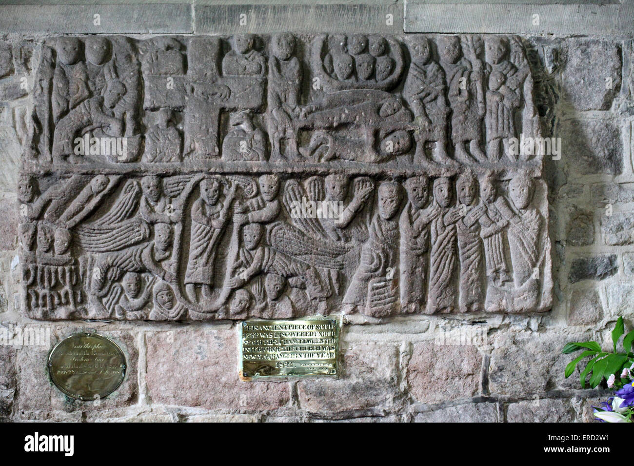 The Wirksworth Stone which is an old coffin lid displayed in St Marys Church - Stock Image