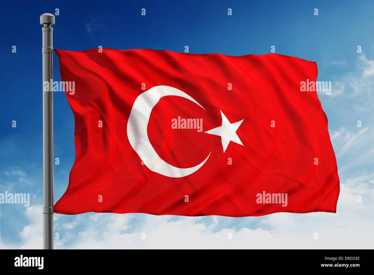 Flag of turkey on blue sky background - Stock Image