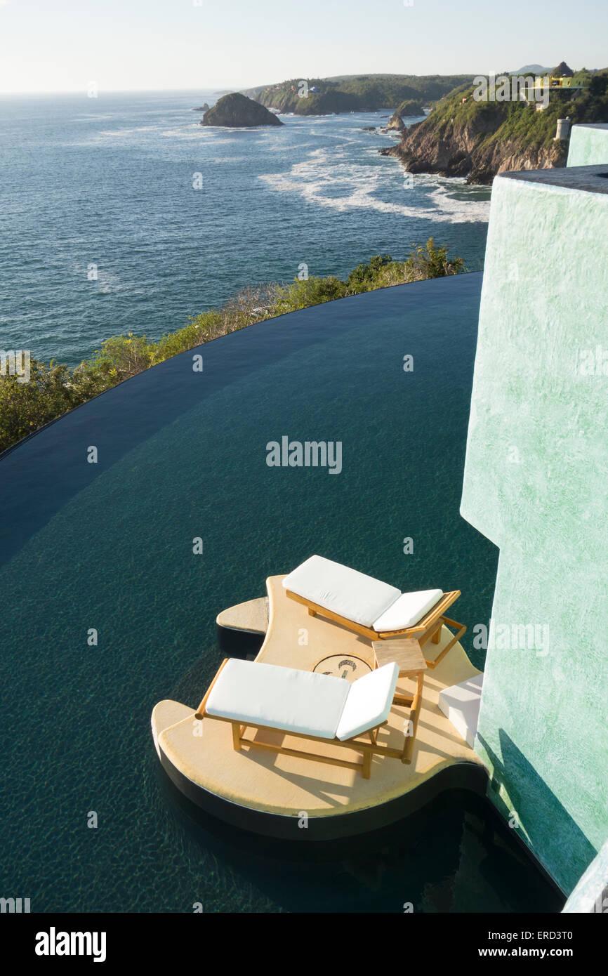 Villa with infinity pool; Careyes; Costa Careyes, Jalisco, Mexico - Stock Image