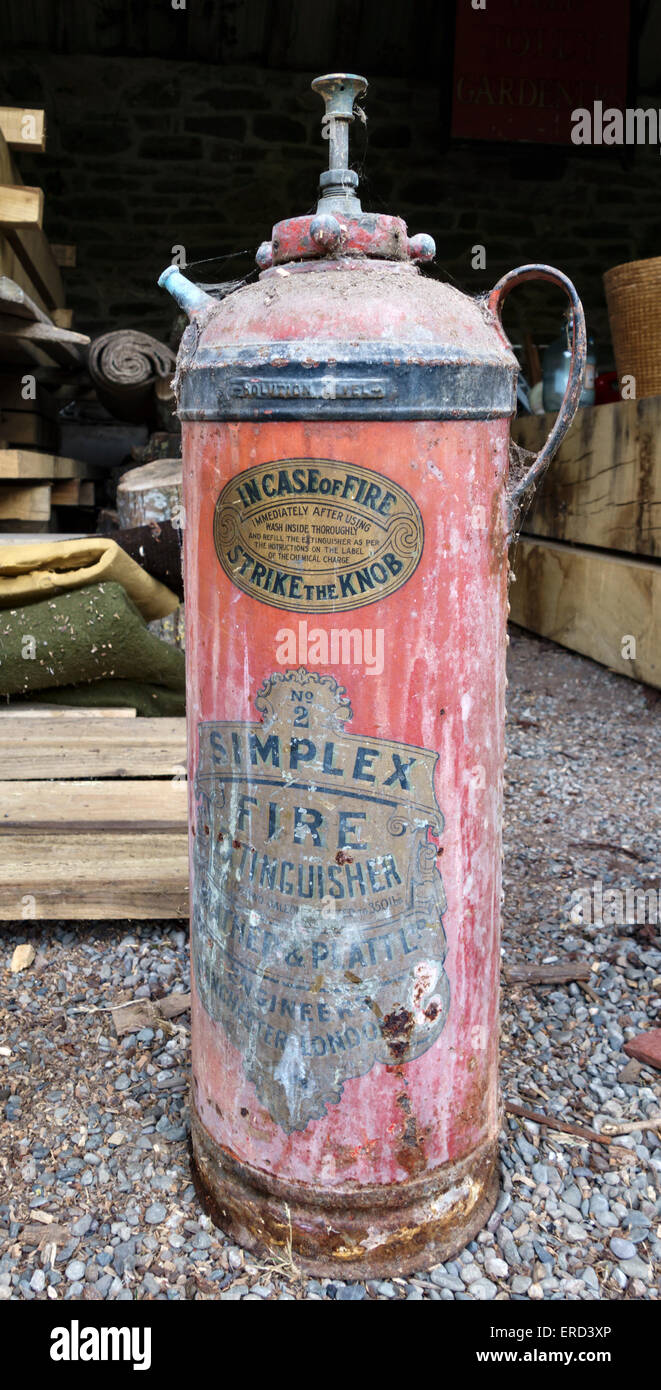 UK. An old Simplex No. 2 fire extinguisher bearing the instruction 'In case of fire, strike the knob' - Stock Image