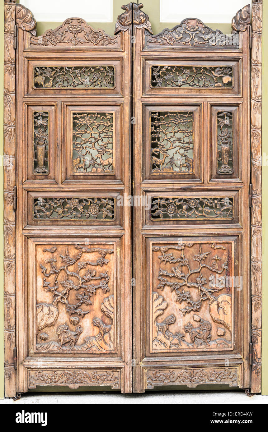 Peranakan carved wooden doors on a Baba-Nonya shophouse, Singapore - Stock Image