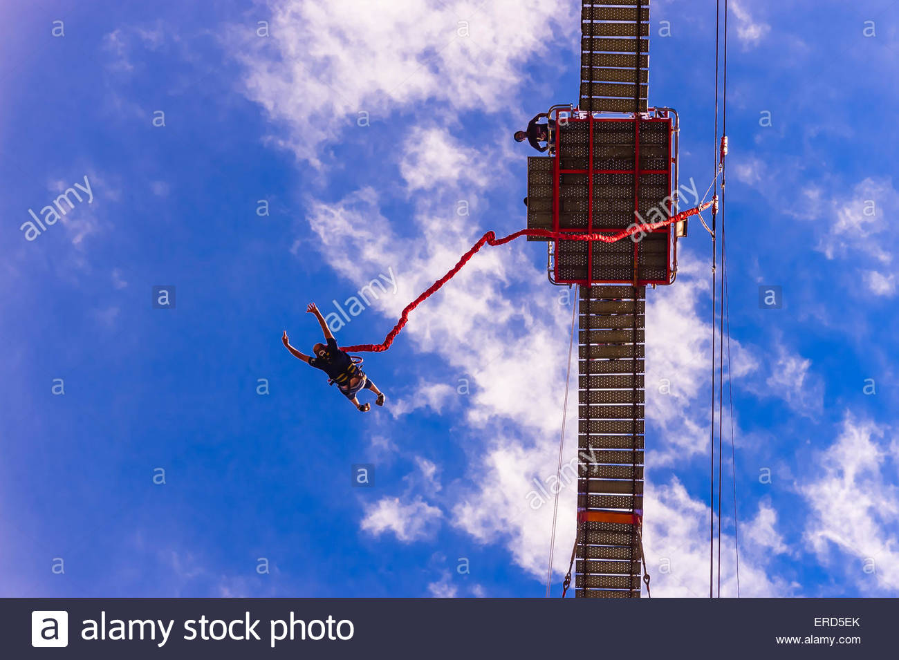 Man jumping off of the 100 meter (328 foot) bungee jump at Orlando