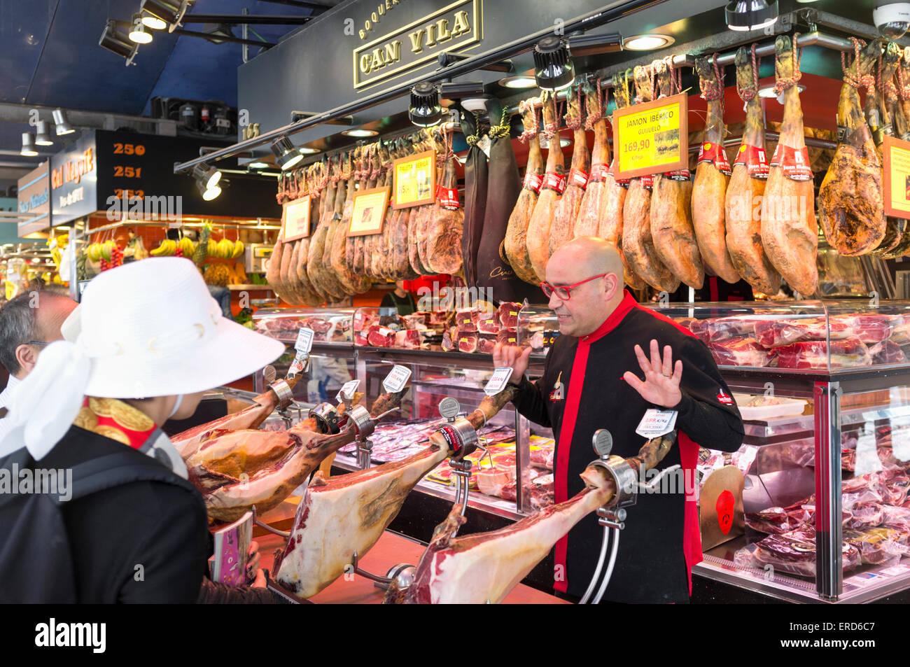 Serrano ham at La Boqueria market, Barcelona, Spain - Stock Image
