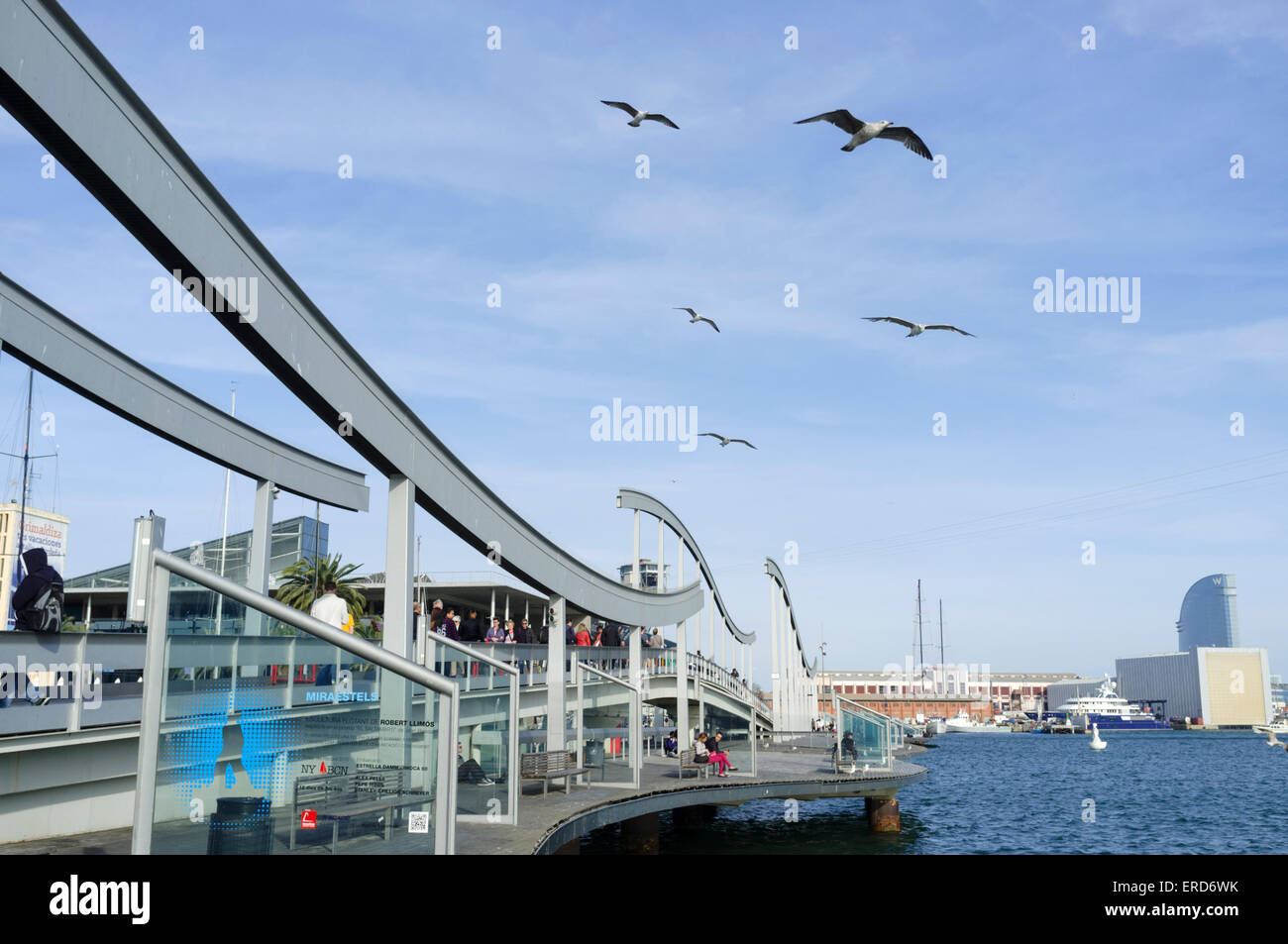 Seagulls flying over the Maremagnum mall at Port Vell harbour, Barcelona, Spain - Stock Image