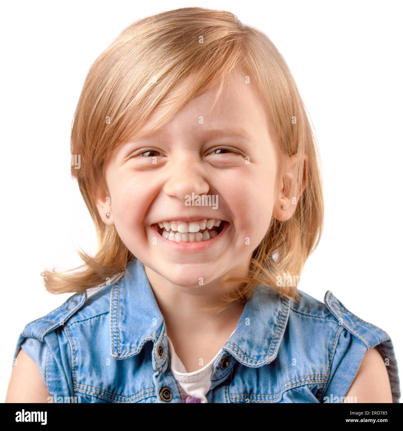 Cute happy girl laughing and having fun - Stock Image