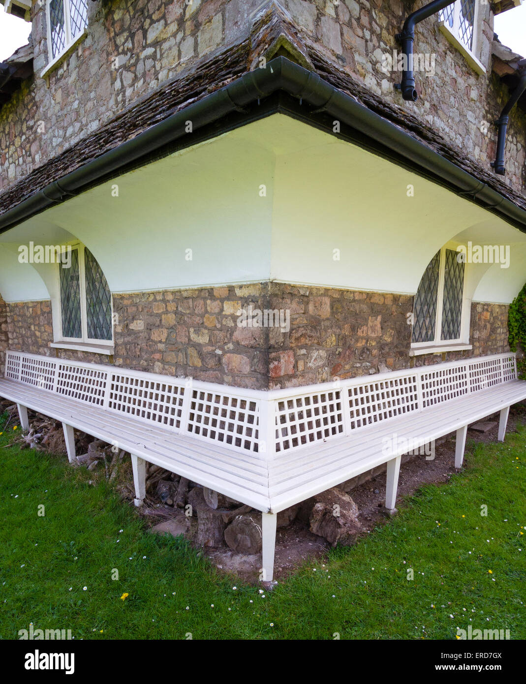 Benched corner of Diamond Cottage at Blaise Hamlet - a Picturesque style group of nine cottages designed by John - Stock Image