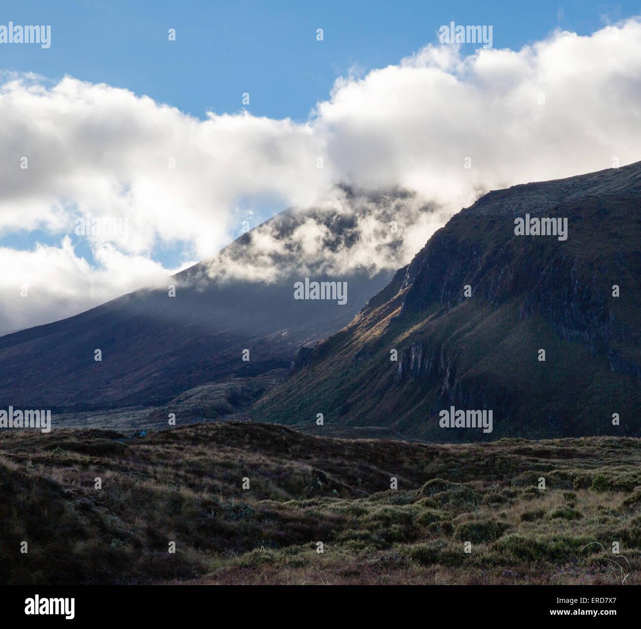 Mount Ngauruhoe shrouded in morning cloud on the Tongariro Alpine Crossing North Island New Zealand - Stock Image