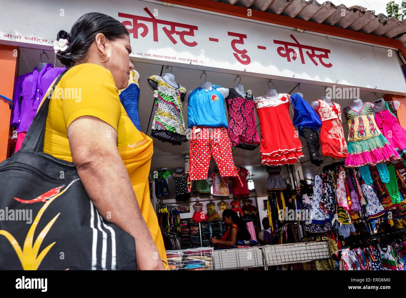 Mumbai India Asian Lower Parel Sunday Market shopping selling sale woman Hindi children's clothing store business Stock Photo
