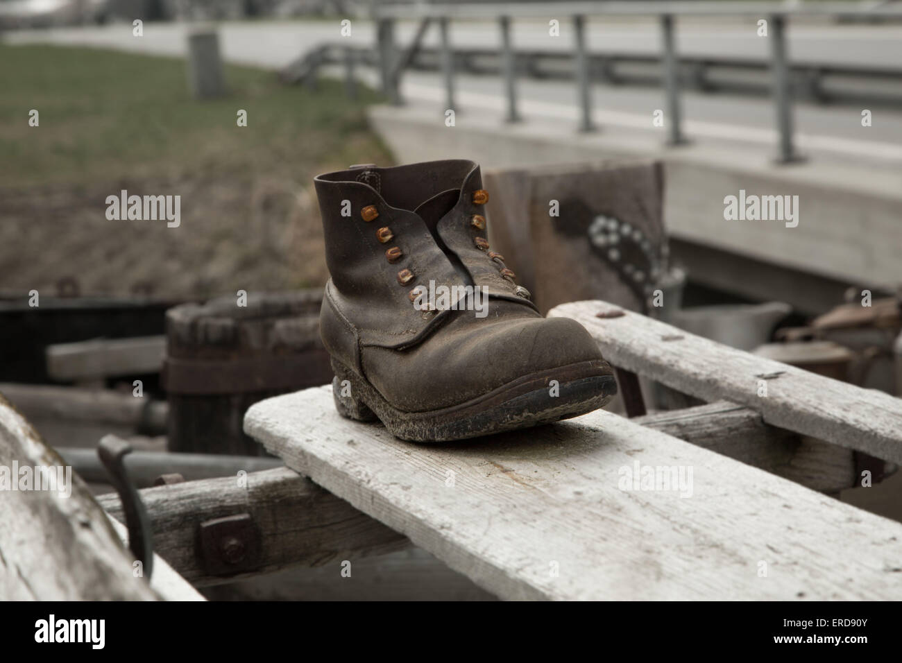 Single old fashion shoe on a wooden table - Stock Image