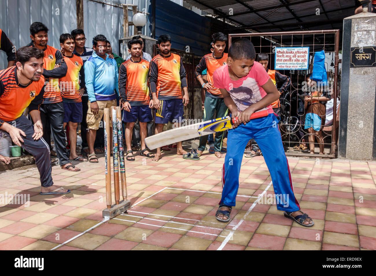 Mumbai India Asian Lower Parel Dhuru Wadi Sitaram Jadhav Marg box cricket game charity event bat player man boy - Stock Image