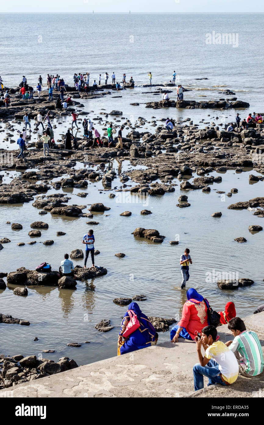 Mumbai India Asian Worli Haji Ali Dargah mosque causeway Haji Ali Bay low tide Arabian Sea family Muslim - Stock Image