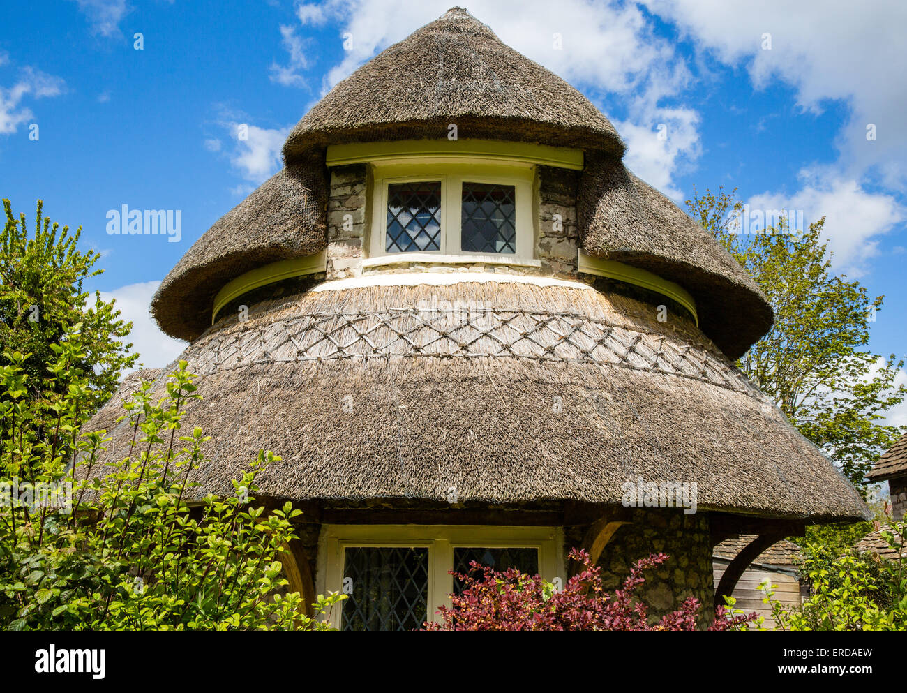 Circular Cottage Blaise Hamlet - a Picturesque style group of nine cottages around a green designed by John Nash - Stock Image
