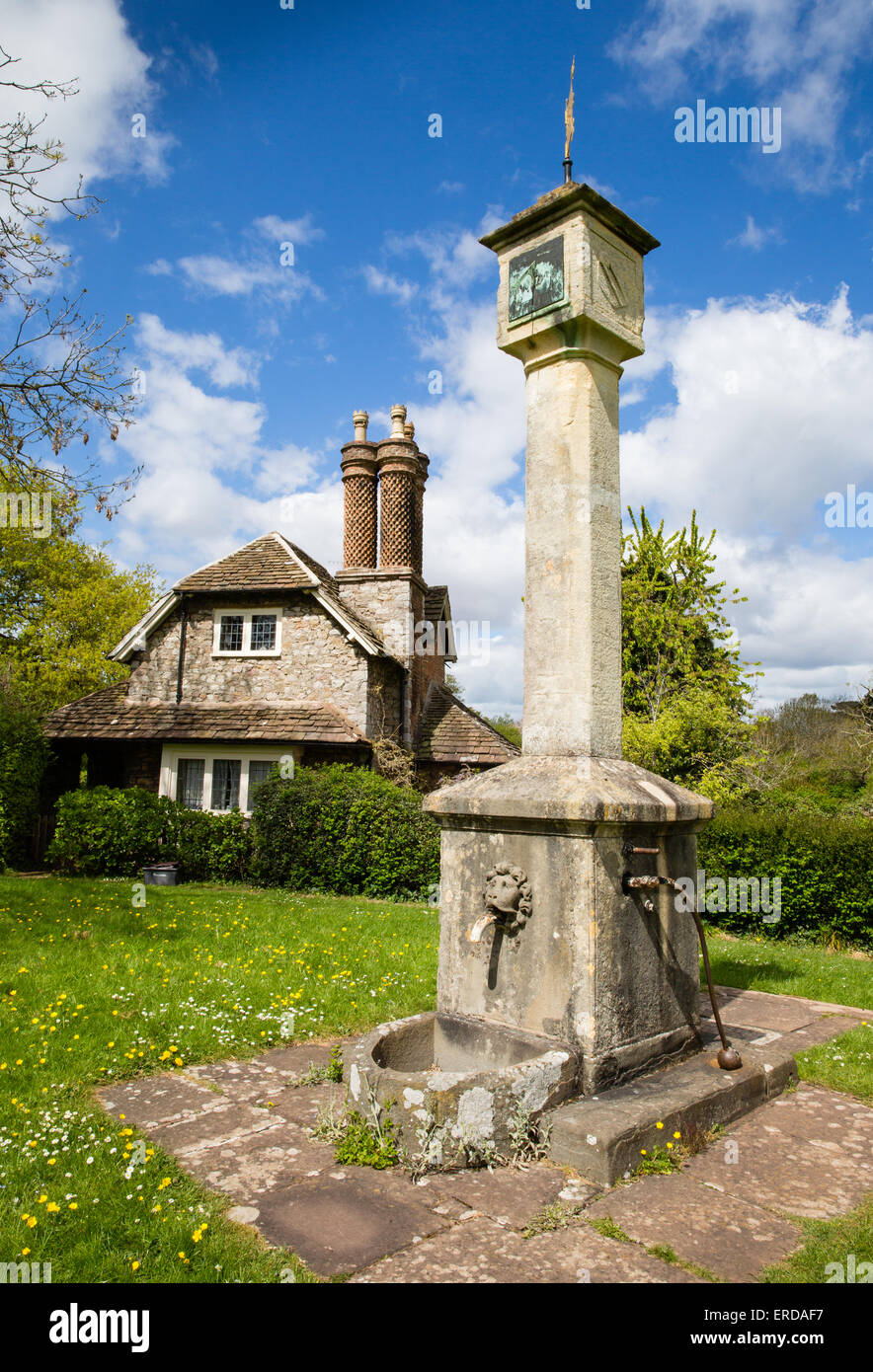Dial Cottage and sundial / village pump at Blaise Hamlet - a  group of nine cottages around a green designed by - Stock Image