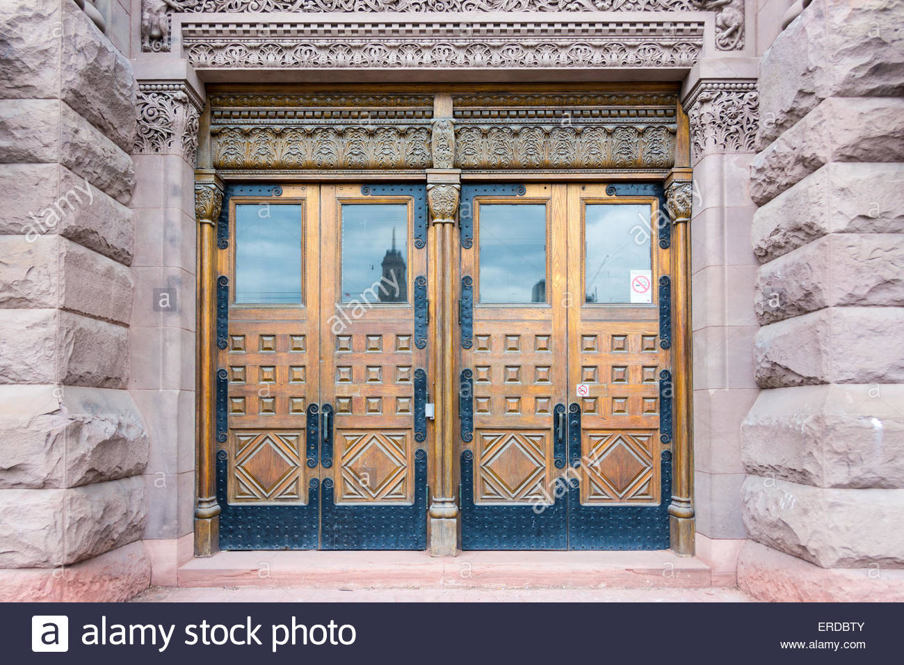 Beautiful old front doors on the facade of the building old city hall the building has a variation of romanesque revival archit