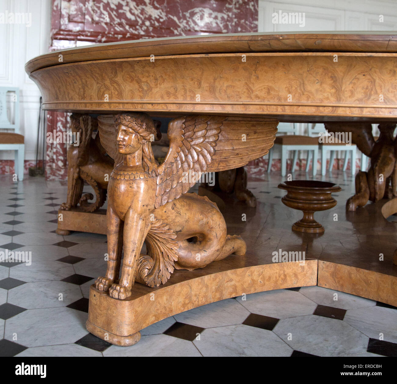 A carved Greek sphinx in the antechamber of Madame de Maintenon's room of the Grand Trianon at the Château - Stock Image