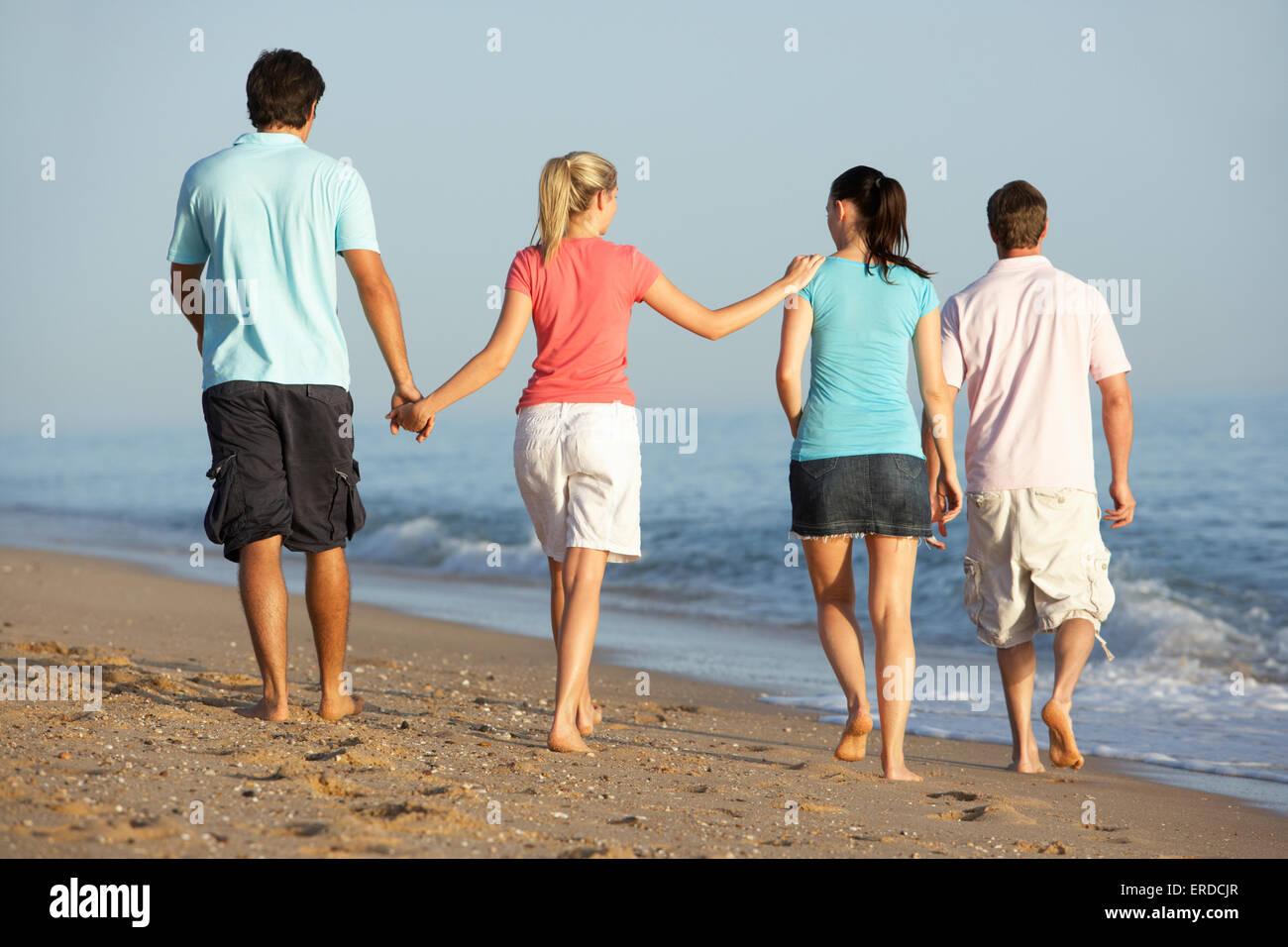 woman,walk,walking,beach,Lifestyle,Caucasian,Female,twenties,20s,outdoors,beach,enjoying,relaxed,relaxing,holiday,vacation,full - Stock Image