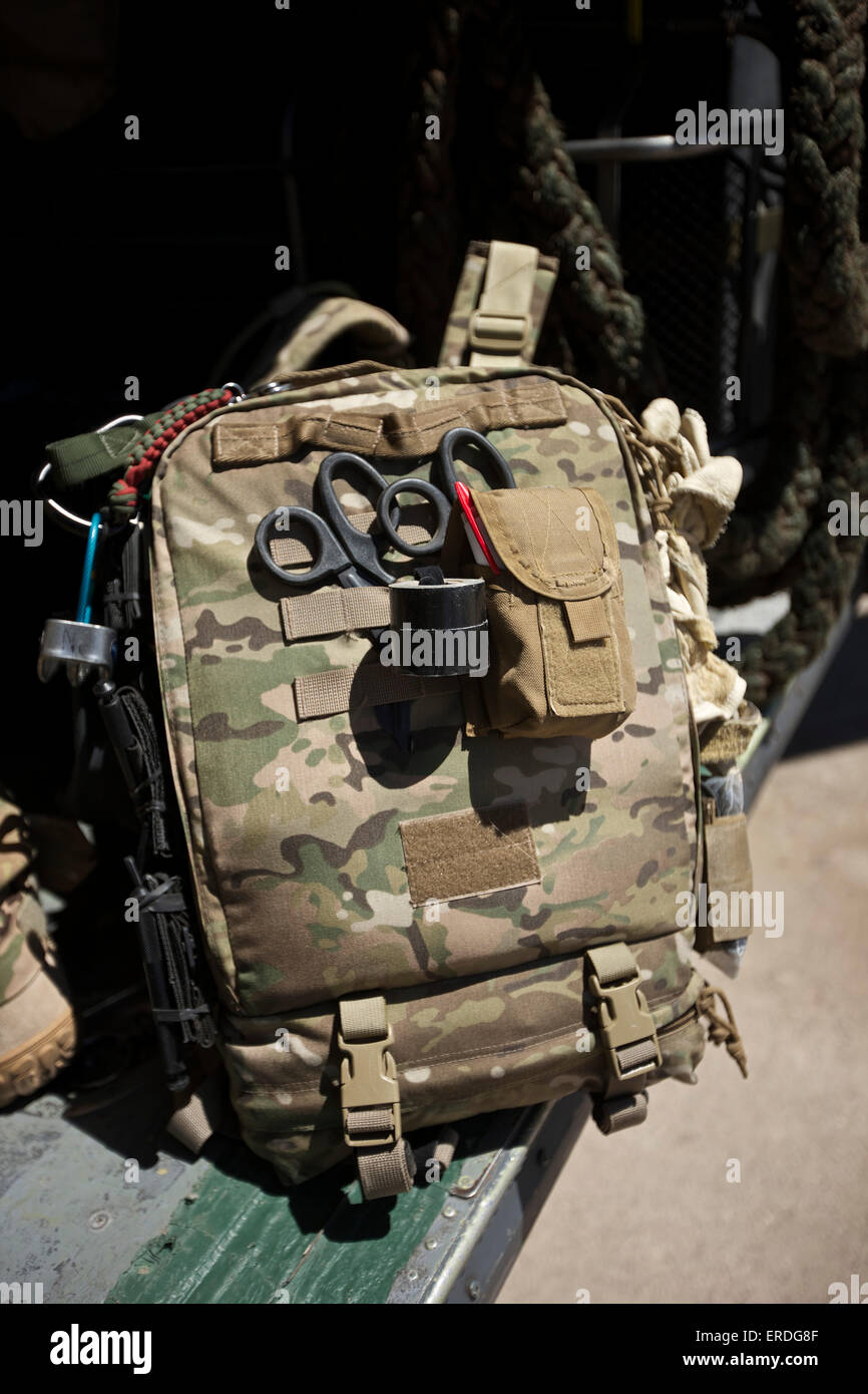 Pararescuemen equipment beside a HH-60G Pave Hawk. - Stock Image