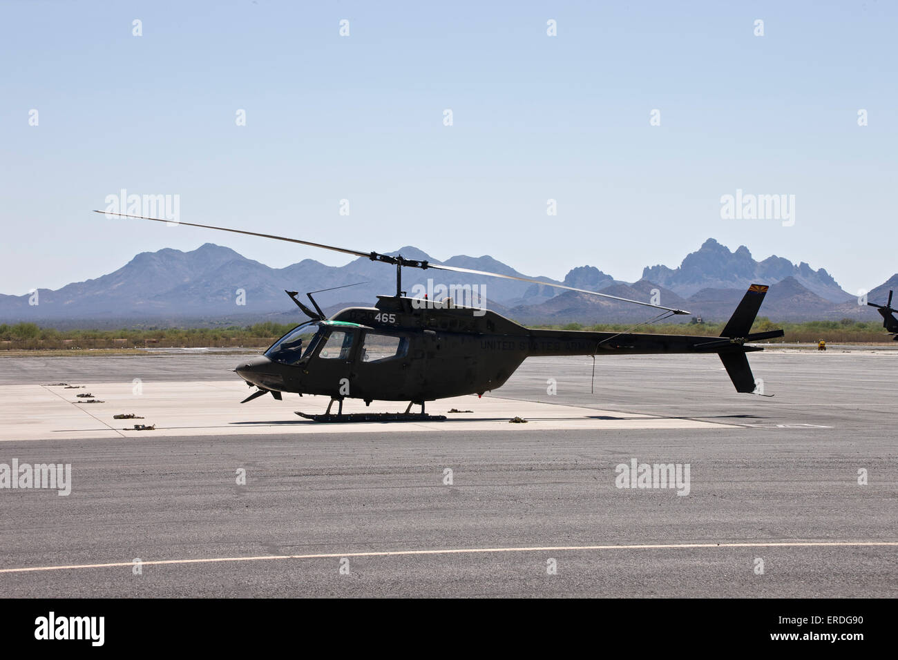 An OH-58 Kiowa helicopter of the U.S. Army on the tarmac at Pinal Airpark, Arizona. - Stock Image