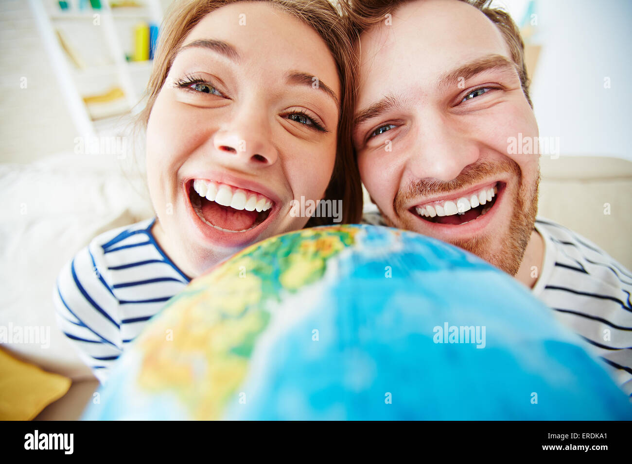 Ecstatic dates looking at camera - Stock Image