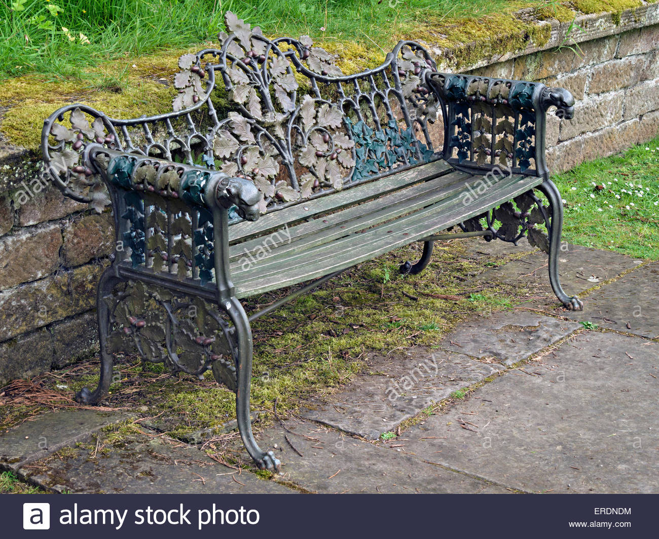 Ornate painted cast metal and wood garden bench seat with ...