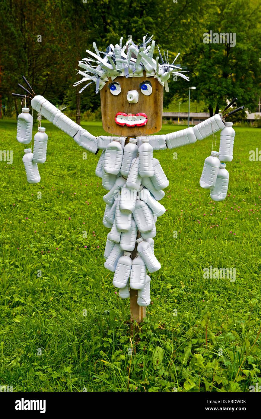 Scarecrow made of plastic bottles, heritage museum in Trubschachen, Canton of Bern, Switzerland - Stock Image