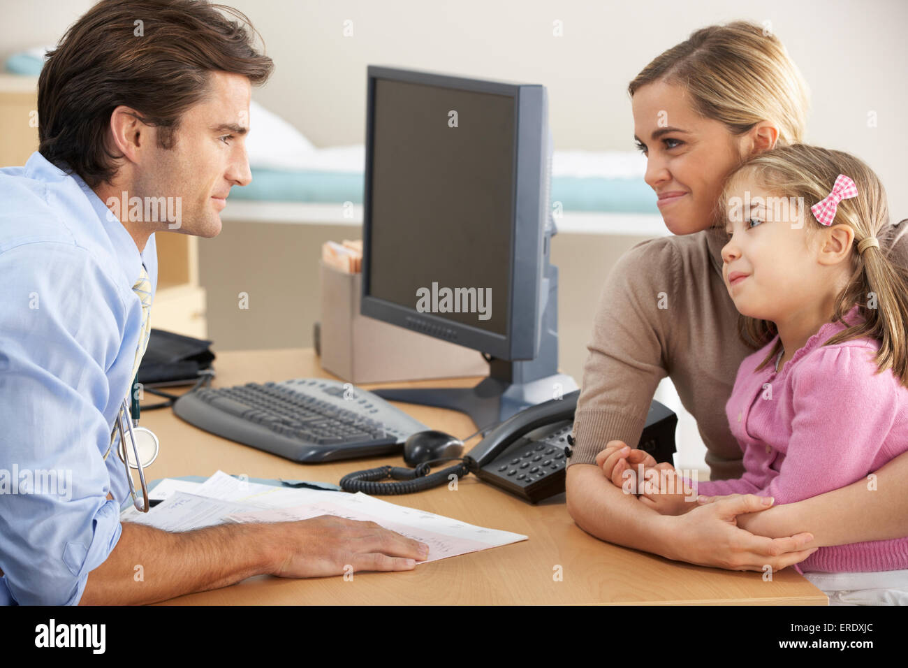 Doctor talking to mother and child Stock Photo