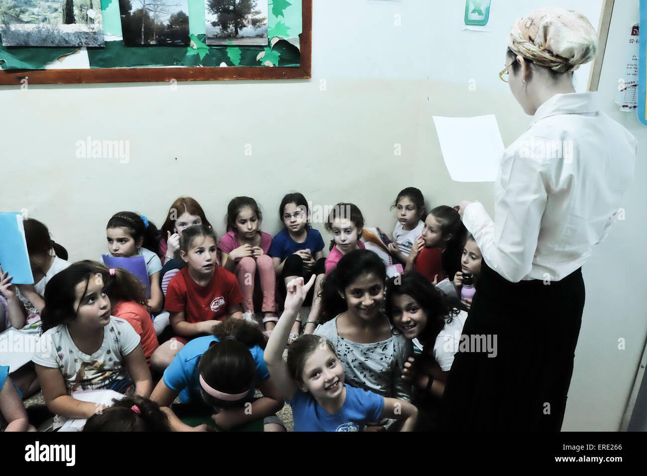 Jerusalem, Israel. 2nd June, 2015. Teachers verify full attendance as students of the Evelina De Rothchild Elementary - Stock Image