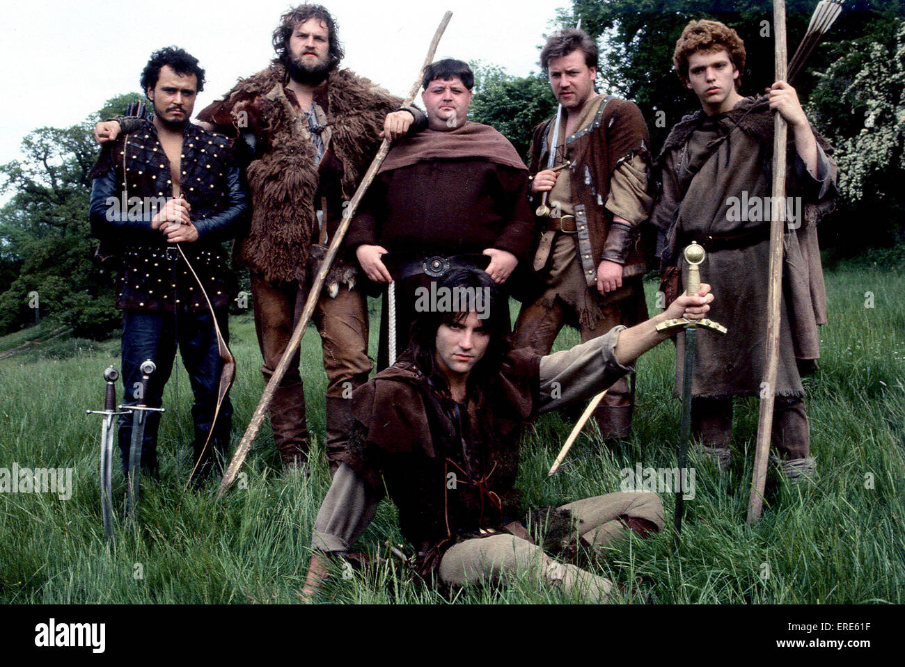Michael Praed as Robin Hood with and his merry men (one being a very young Ray Winstone second from right back row) - Stock Image