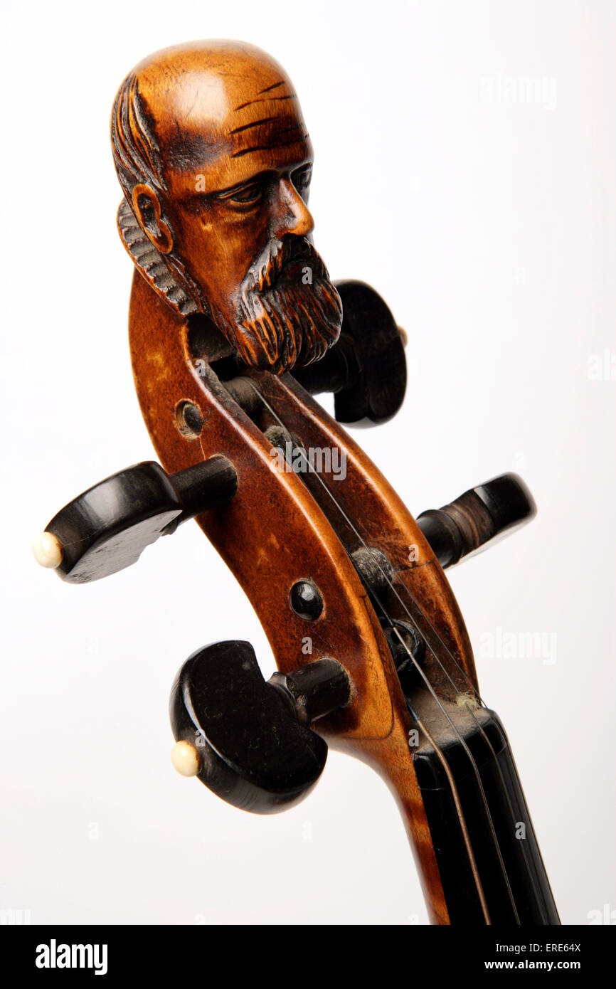 carved-head-at-the-top-of-a-violin-scroll-violin-labelled-duiffoprugcar-ERE64X.jpg