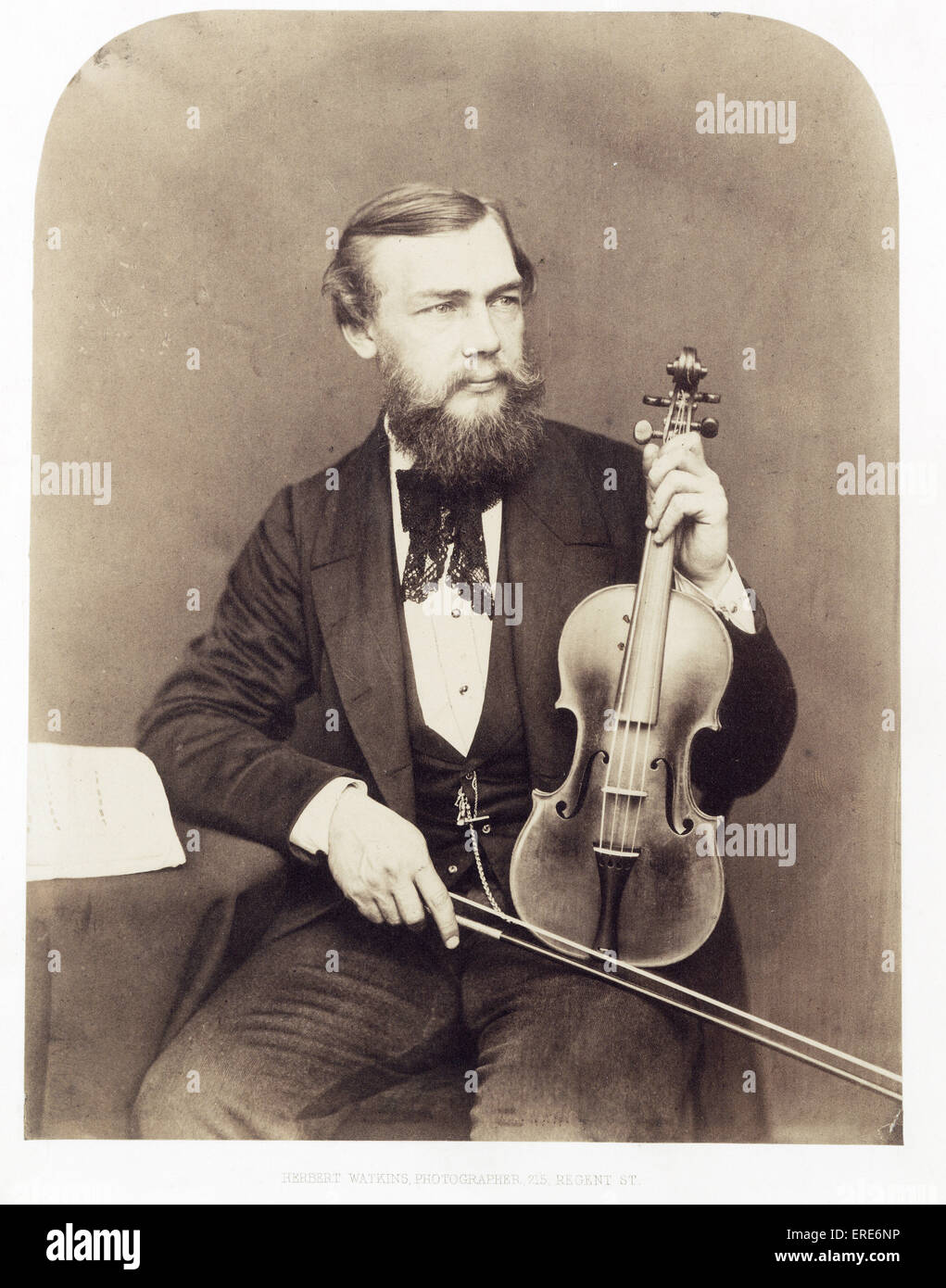 Violinist (unidentified male sitter, anon.) holding a 'Golden Period' instrument by Stradivari, and a bow. - Stock Image