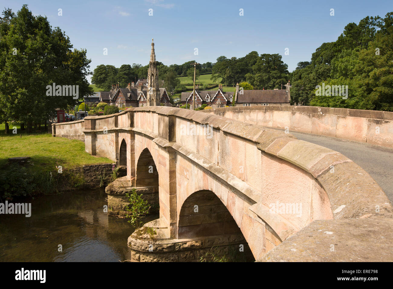 UK, England, Staffordshire, Ilam, bridge over River Manifold and Mary Watts-Russell Memorial Cross - Stock Image