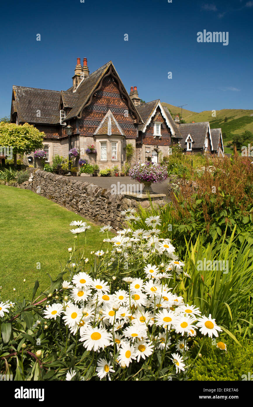 UK, England, Staffordshire, Ilam village, Swiss style Ilam Hall estate houses with floral gardens - Stock Image