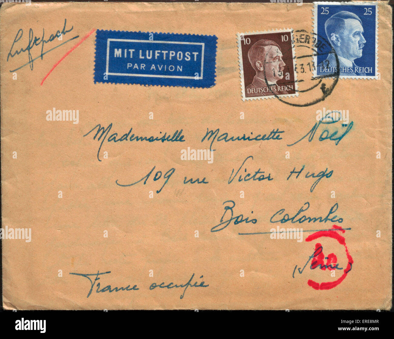 Envelope with German stamps bearing Hitler's portrait, sent from Germany to occupied France in 1943. - Stock Image