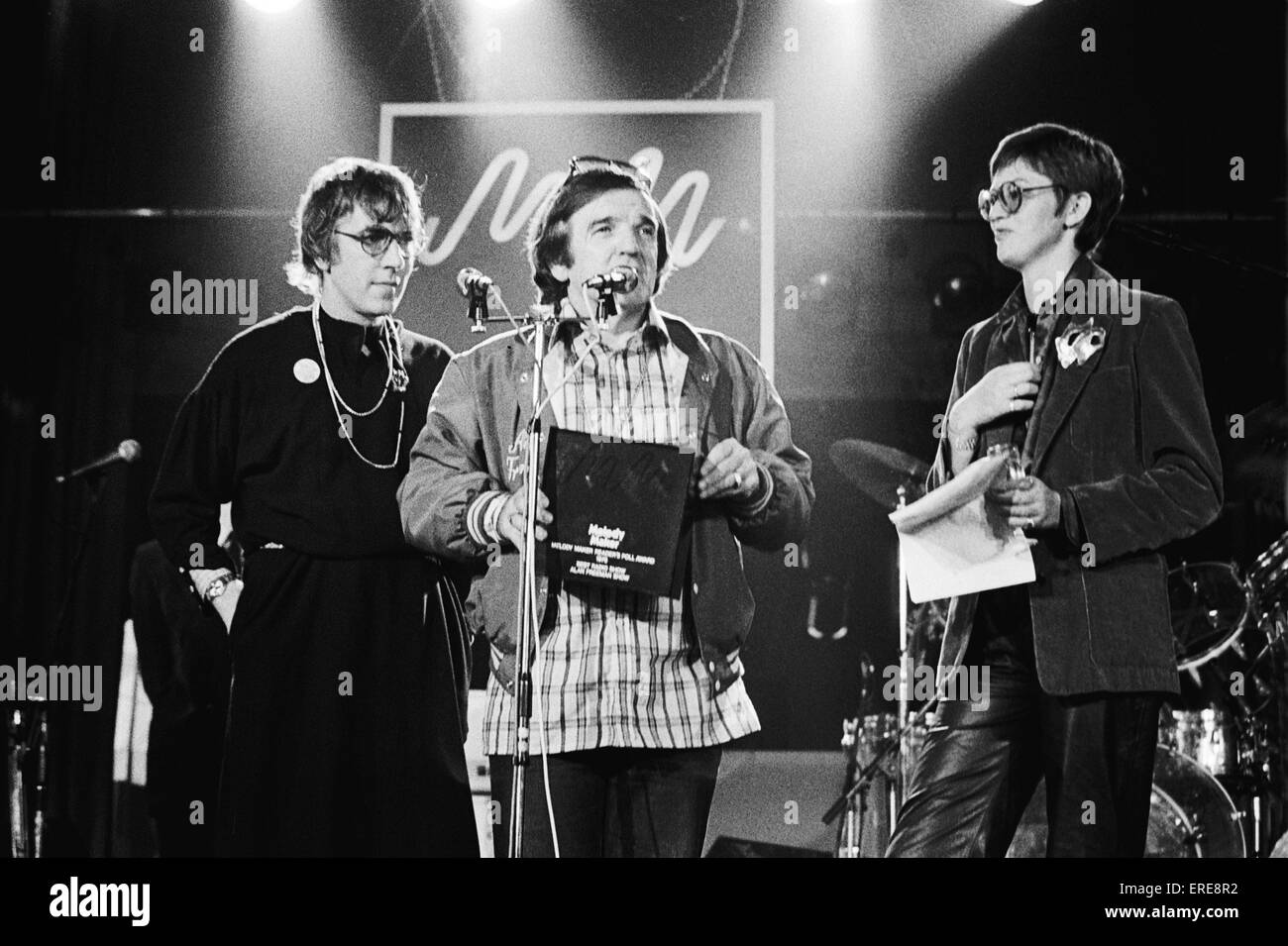 Australian DJ Alan 'Fluff' Freeman, MBE (1927-2006) receiving an award from Peter Cook (wearing a dress) - Stock Image