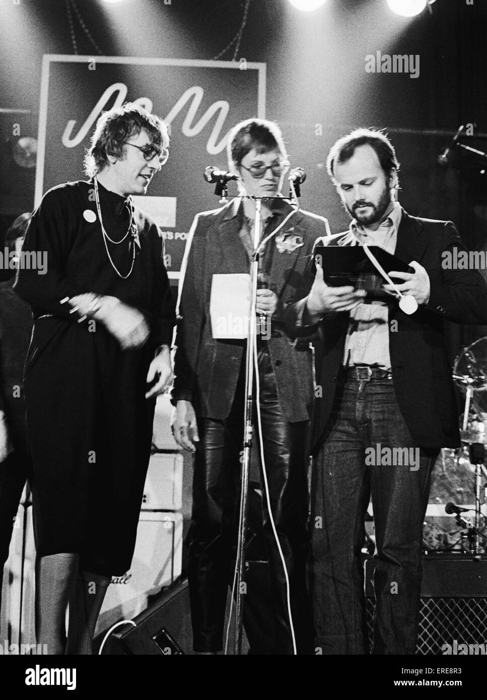 British DJ John Peel, OBE (1939-2004) receiving an award from Peter Cook (wearing a dress) and Janet Street-Porter - Stock Image