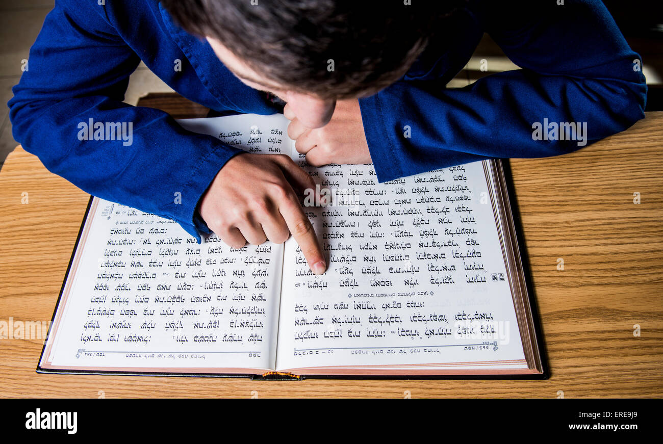 a jewish scholar reading a religious script - Stock Image