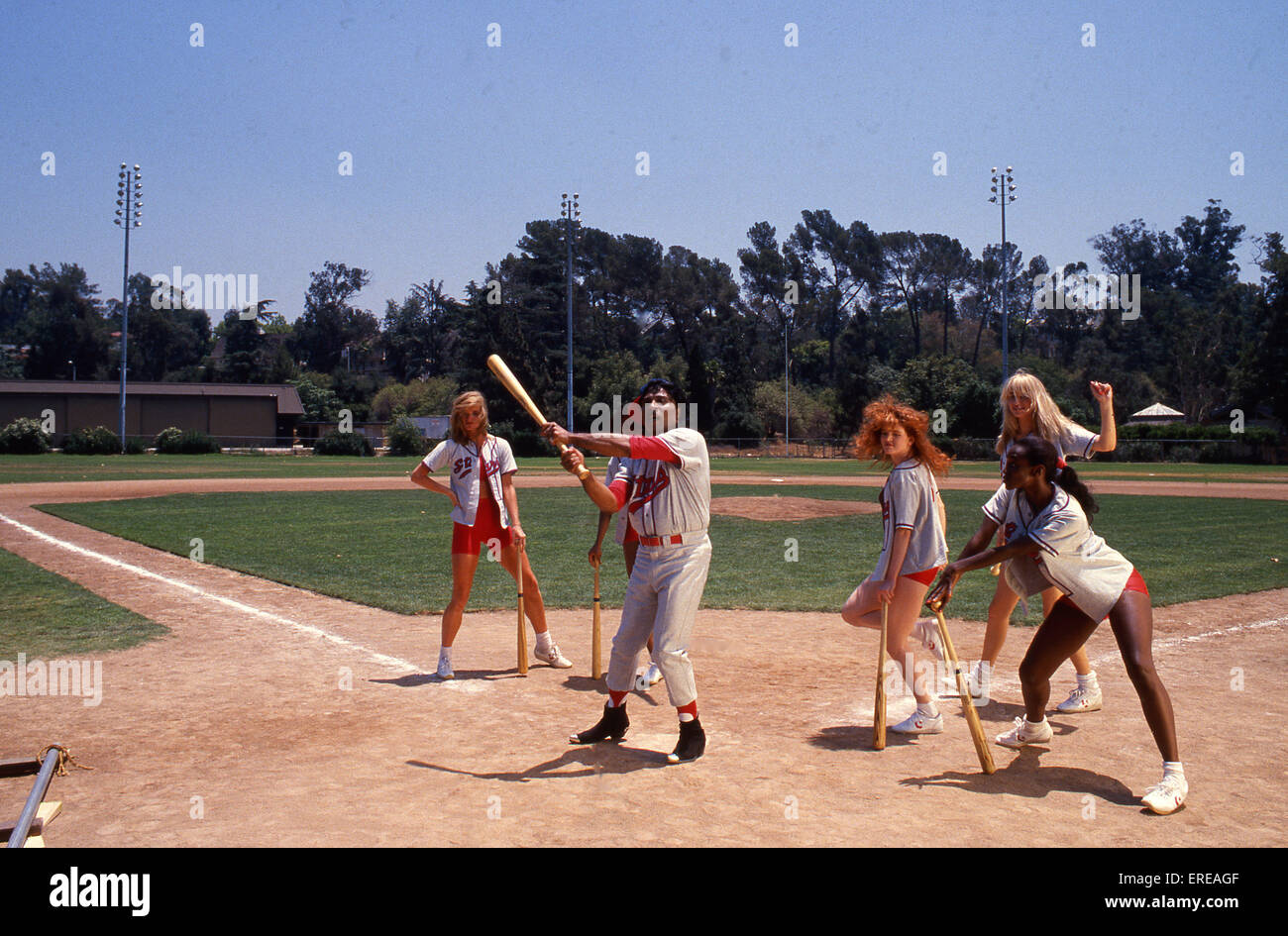 Portrait of Little Richard on a baseball pitch, with posed female fielders, Los Angeles, USA. Little Richard, American - Stock Image