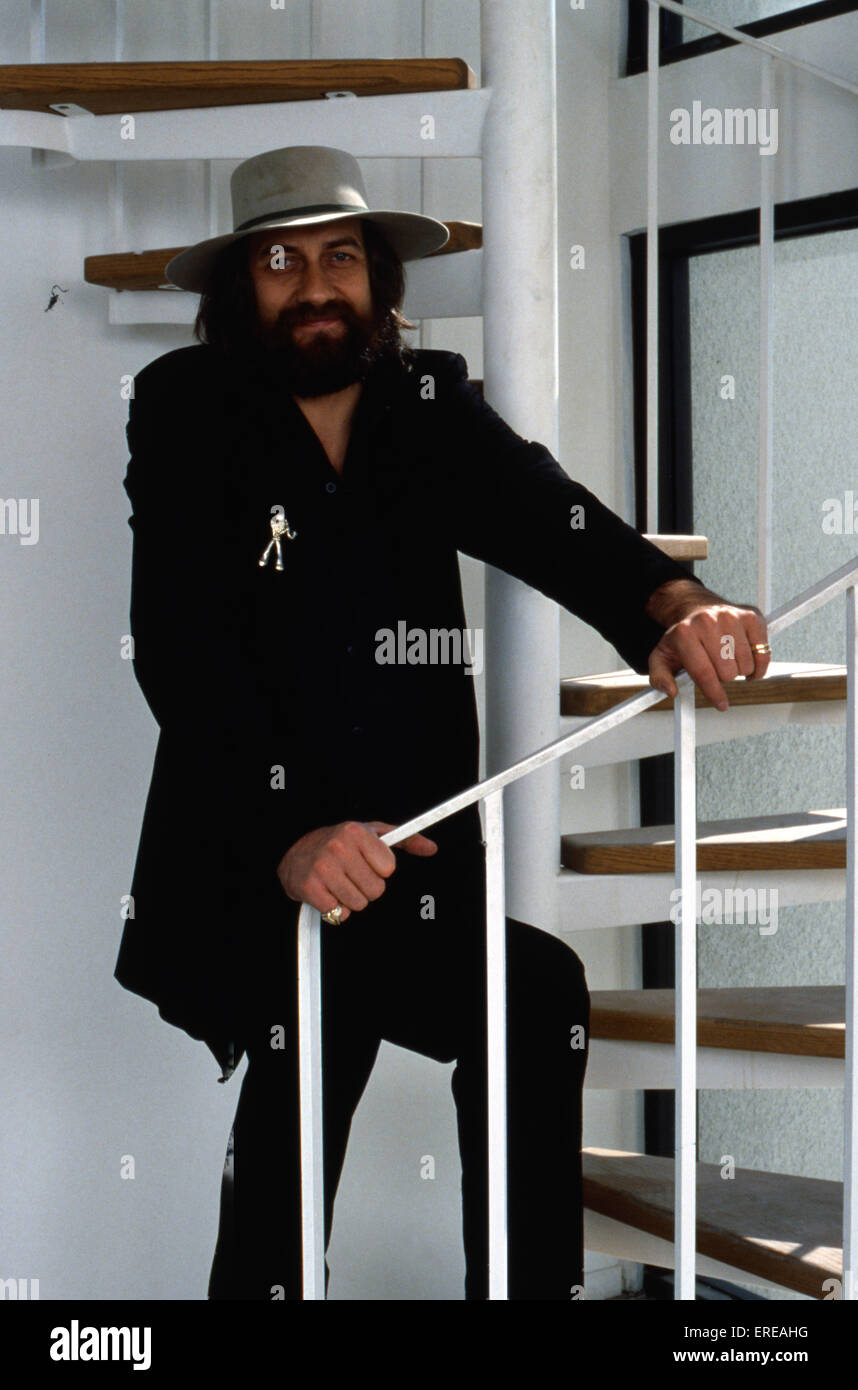 Portrait Of Mick Fleetwood In A Grey Hat Beside A Spiral Staircase